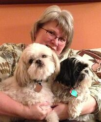 Admin Asst Anne DeHaan with Teddy (white) and Fenway the Shih Tzus. Fenway is Teddy's best friend