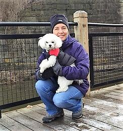 Amy and Buddy talking a winter walk in Dexter MI — with Amy Maier.
