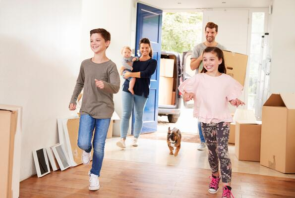 Family moving with dog - GettyImages-871996388 (1)