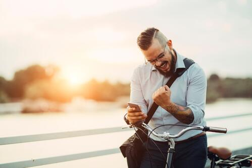 Man with bike and cell phone - GettyImages-482983366