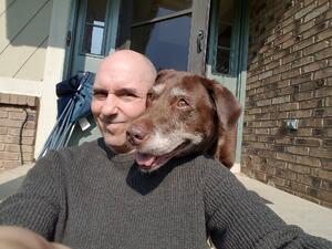 Sr LO Ray Singer and the Chocolate Lab Cocoa Bella — with Ray Singer.
