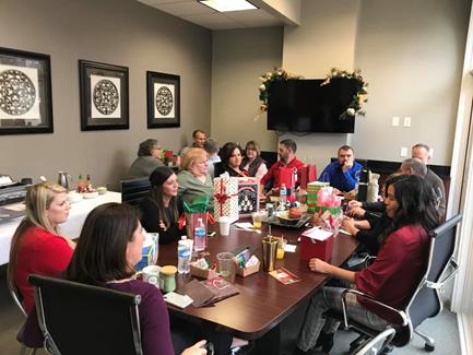 Secret Santa gift exchange at Ruoff Home Mortgage's Bloomington, Indiana branch