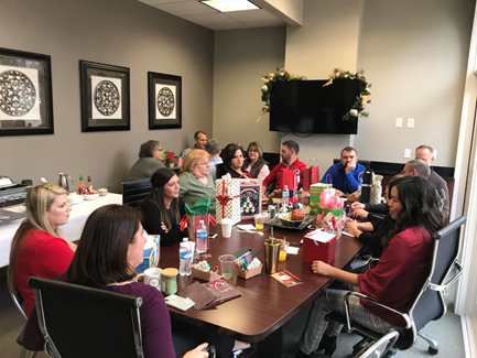 Secret Santa gift exchange at Ruoff Home Mortgage's Bloomington, Indiana branch