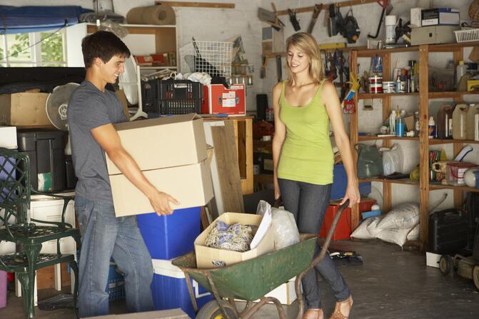 Two teens cleaning the garage