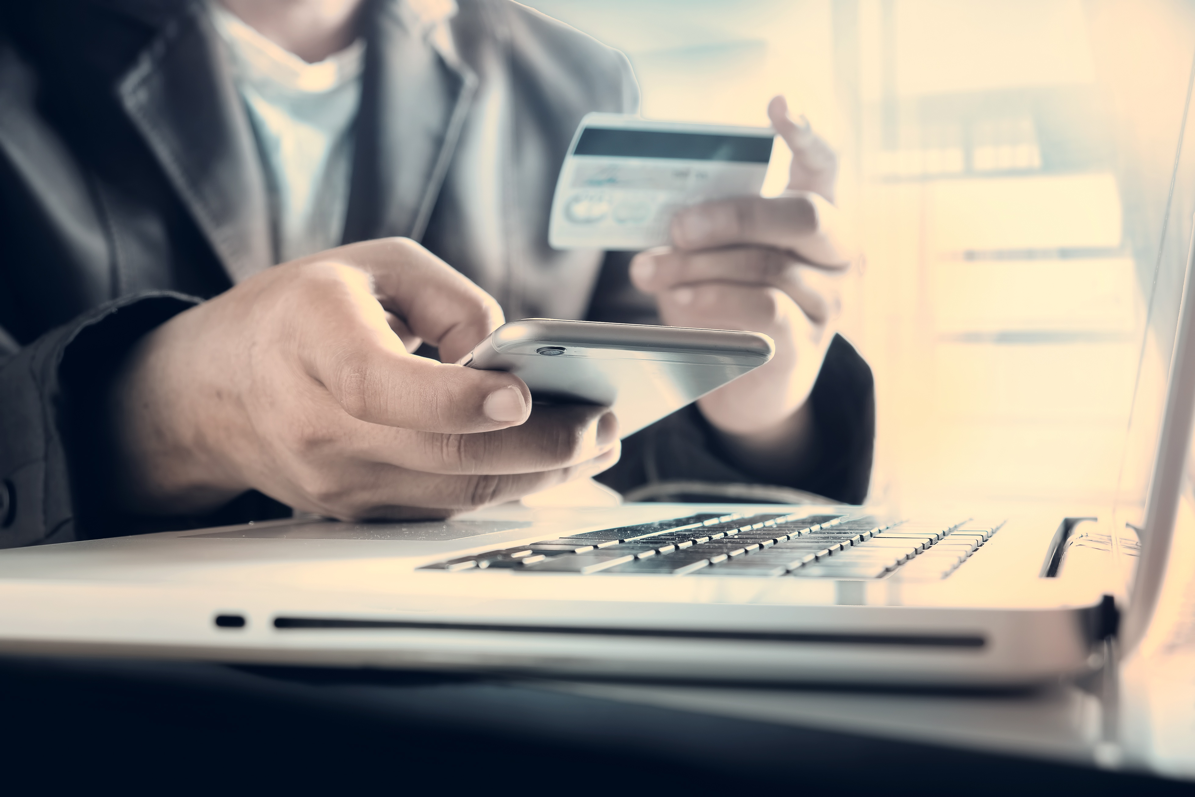 Man using a credit card on laptop